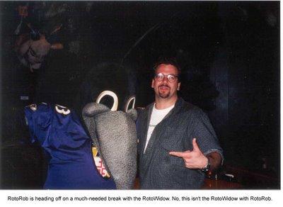 Rob Blackstien, RotoRob, posing with the Baltimore Ravens' mascot.