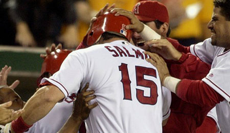 Longtime Los Angeles Angels outfielder Tim Salmon has hung them up.