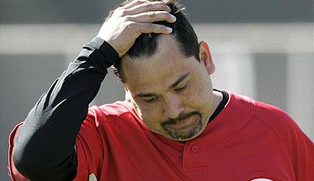 Cincinnati Reds relief pitcher Eddie Guardado faces an uphill battle after Tommy John surgery.
