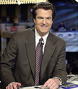 Football analyst Mel Kiper and his finely-tuned pompadour.