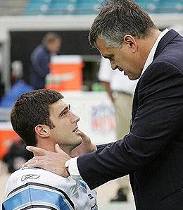 Detriot Lions GM Matt Millen chokes flop quarterback Joey Harrington with his bare hands.