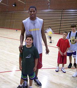 Indiana Pacers swingman Danny Granger poses with Metri, James' son.