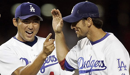 Dodgers' closer Takashi Saito, left, has silenced his critics.