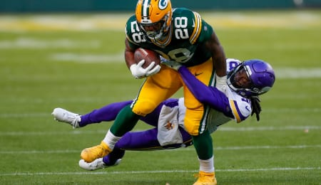 AJ Dillon tested positive for Covid-19 for the Green Bay Packers.